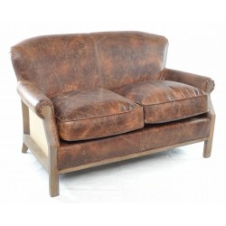 A traditionally shaped sofa with leather top and hessian sides and back on a solid wood frame and legs