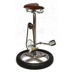 Bar stool made to imitate a bike with a bicycle saddle and pedals for footrests, the base is a bike wheel with tyre