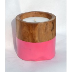 Teak candle made from reclaimed teak root with a pink painted band round the bottom half