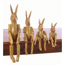 Wooden Set of 4 Sitting Natural Rabbits with articulated arms and legs designed to sit on the edge of a shelf