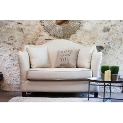 Two Seater Cream Sofa with a curved back and arms