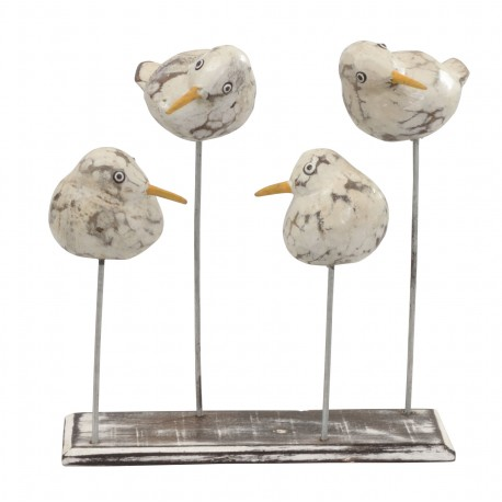 Wooden bird ornament with four white round birds on posts on a flat wood stand