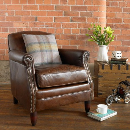 Vintage leather armchair with stud detail on a solid wood frame