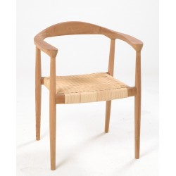 Solid wood chair with a frame made from teak and left open and the seat made from woven rattan