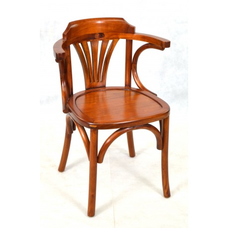 A bentwood arm chair with a solid seat and traditional polished finish