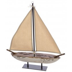 A solid wood decorative sail boat with linen sails and a distressed wood hull