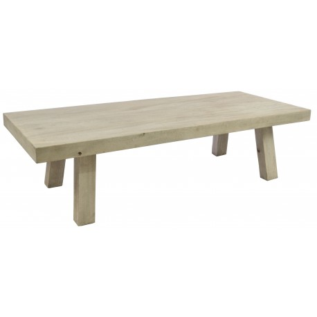 Solid wood coffee table with a deep solid table top on chunky legs finished with a stripped back old style finish