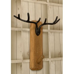 Wall hanging coat hook with single hook made from reclaimed pine and finished with a black metal stags antlers motif