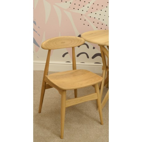 Solid wood dining chair with a oval back piece on post back and a solid seat all finished in a plain wood finish