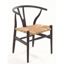 Solid wood chair with a rush seat and a plain wood finish designed in an curved wishbone style