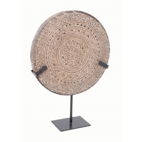 Solid disc with maze design on a black stand
