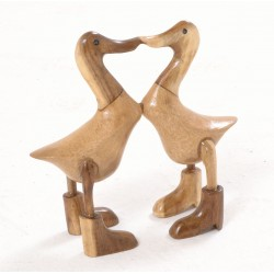 Pair of mall bamboo ducks with booted feet kissing each other and with a polished laquer fininsh