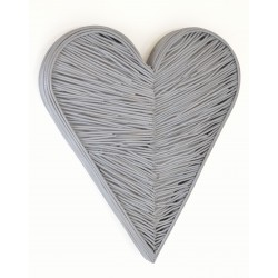 Woven rattan wall art in a 3d heart shape painted in a matt grey finish