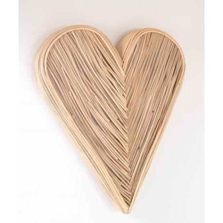 Woven rattan wall art in a 3d heart shape painted in a natural finish