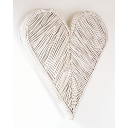 Woven rattan wall art in a 3d heart shape painted in a white finish