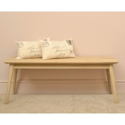 Retro style bench with simple round legs and flat seat with rounded corners